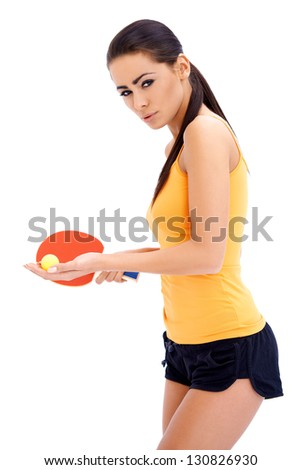 Female table tennis player is ready to serve a ball - stock photo