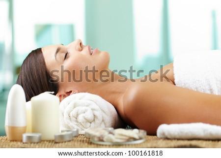 Female taking pleasure before spa procedure - stock photo