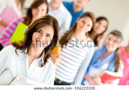 Female teacher with group of students at the university - stock photo