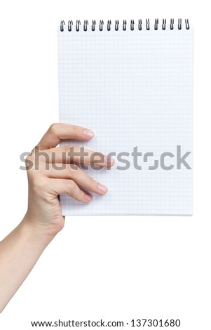 female teen hand holding notebook on a spring with blank page to write something, isolated