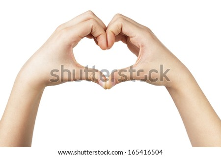 female teen hand makes heart shape with hands, white background