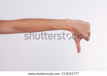 Female teen hand shows thumbs down