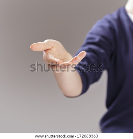 female teen hand to presenting or showing something, selective focus - stock photo
