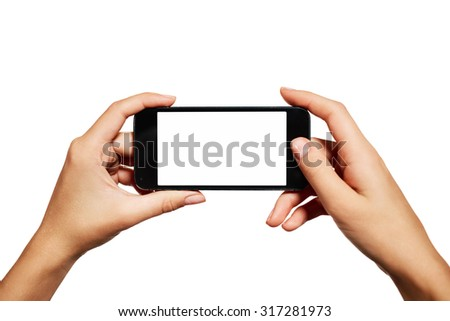 Female teen hands using mobile phone with white screen, isolated on white background.