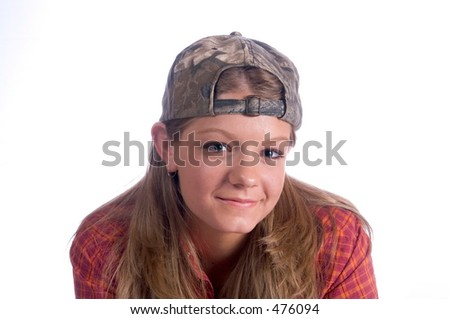 female teen with hat on backwards