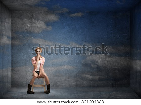 Female teenager girl on sky background in empty room
