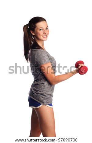 Female teenager with dumbbell