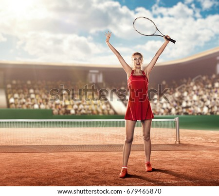 female tennis player celebrates victory holding a tennis racket above her head