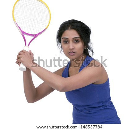 Female tennis player posing with tennis racket