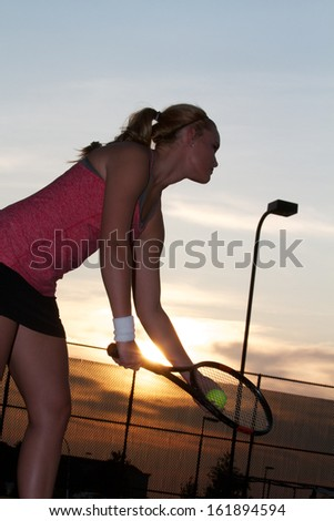 Female Tennis Player Preparing to Serve - stock photo