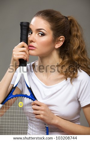Female tennis player with racket - stock photo