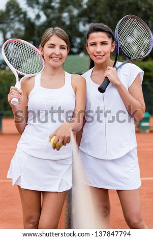 Female tennis players ready to play a match
