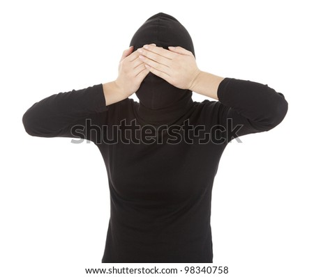 female thief in black clothes covering eyes, white background - stock photo