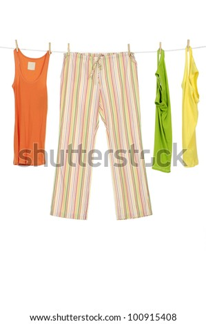 female three colorful shirt and trousers clothespins on rope - stock photo