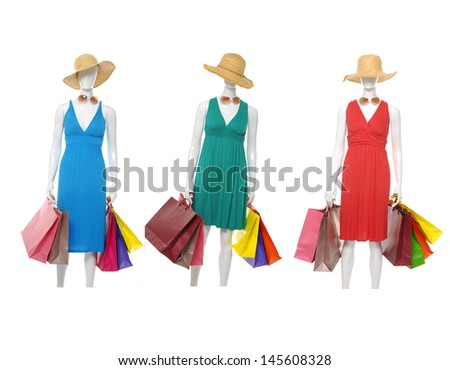 Female three mannequin with colorful bag in a hat - stock photo
