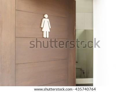 Female toilet sign on wooden door. - stock photo