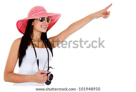 Female tourist holding a camera and pointing - isolated over a white background - stock photo