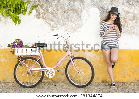 Female tourist living like a local, with her bicycle after buying fresh vegetables - stock photo