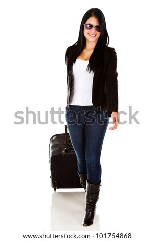 Female tourist walking with her bag - isolated over a hwite backround - stock photo