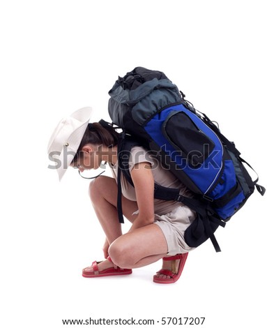 female tourist with backpack isolated on the white background