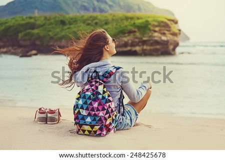 "female traveler admiring a marine view (""instagram"" filter applied) - stock photo"