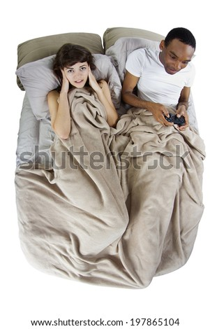 female unable to sleep because of her gamer boyfriend - stock photo