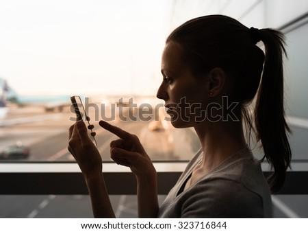Female using her smart phone.  - stock photo