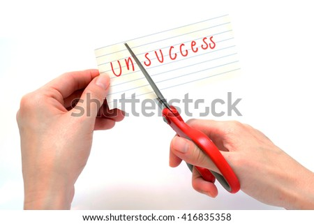 Female using scissors to remove the word unsuccess to read success concept for self belief, positive attitude and motivation