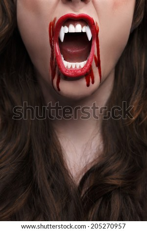 Female vampire with bloody teeth