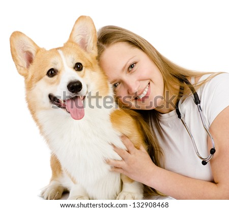 Female veterinarian and Pembroke Welsh Corgi dog. looking at camera. isolated on white background - stock photo