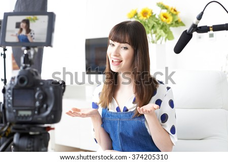Female Vlogger Recording Broadcast At Home - stock photo