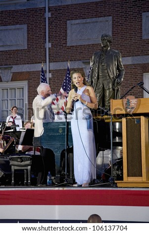 Female vocalist performing with Peter Nero and the Philly Pops at historic Independence Hall, Philadelphia, Pennsylvania on July 3, 2011 - stock photo