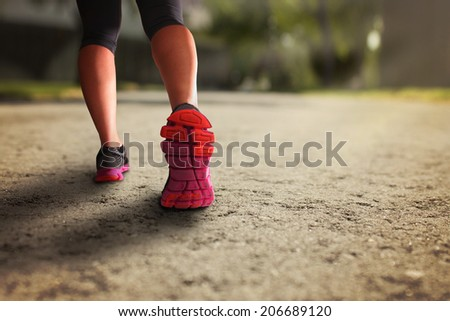 female walking during daytime on path