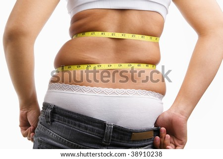 Female wearing jeans that already too small for her, concept to have diet