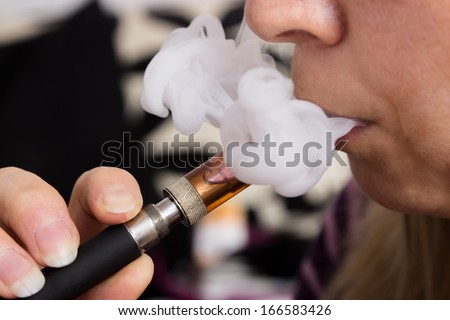 Female with an electronic cigarette