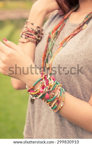female with bracelets