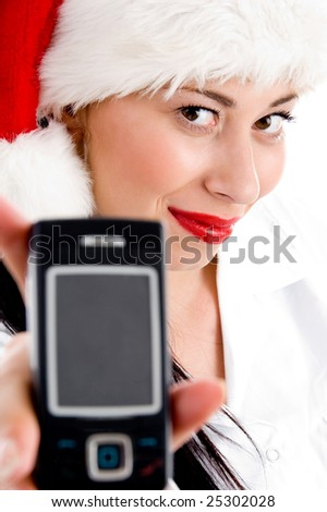 female with christmas hat and showing cell phone with white background - stock photo