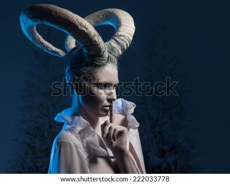 Female with goat body-art. Dedicated to Chinese Horoscope 2015 - Year of the Goat (Sheep)  - stock photo