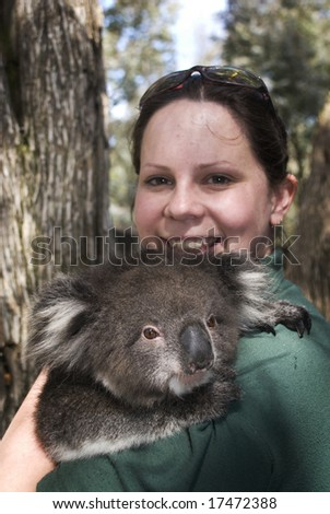 Female with Koala in arms - stock photo