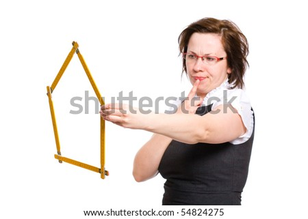 female with thumb up gesture, holds measure in the shape of the house, thinking, wondering, making decision, studio shoot isolated on white background