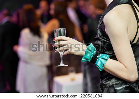 Female woman guest hand and glass with wine at party