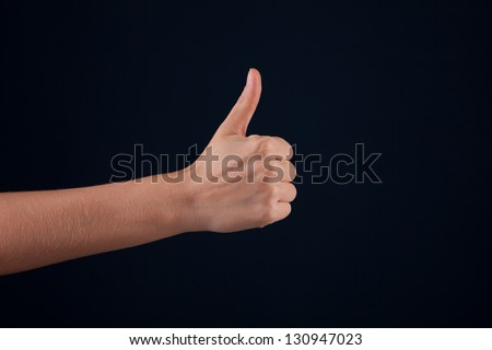 Female woman hand  on the dark background