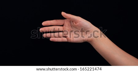 Female woman hand  on the dark background - stock photo