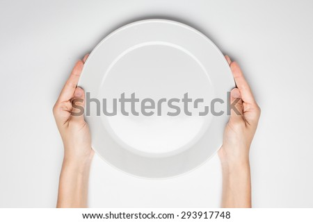 Female(woman) two hands hold(support) a white dish(plate) isolated white and top view - stock photo