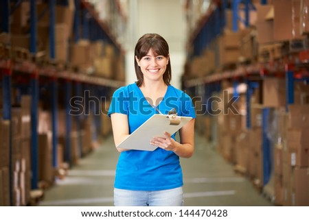 Female Worker In Distribution Warehouse