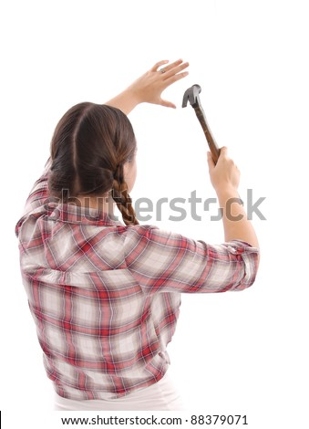 Female worker Using a Hammer - stock photo