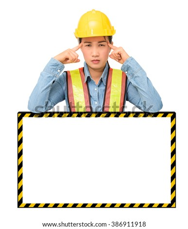 female worker with Protection Equipment, posing behind big white banner, scratching head, looking at camera and thinking and copy space, isolated on white background