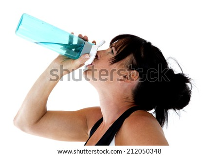 female workout trainer drinking water from bottle - stock photo