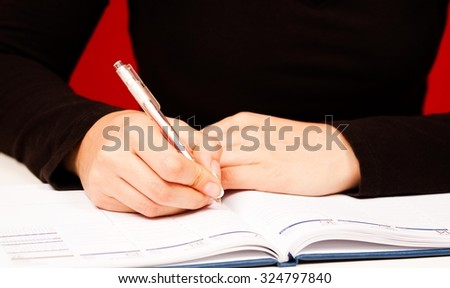 Female writing in her planer