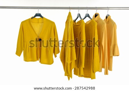 female yellow clothing on hangers